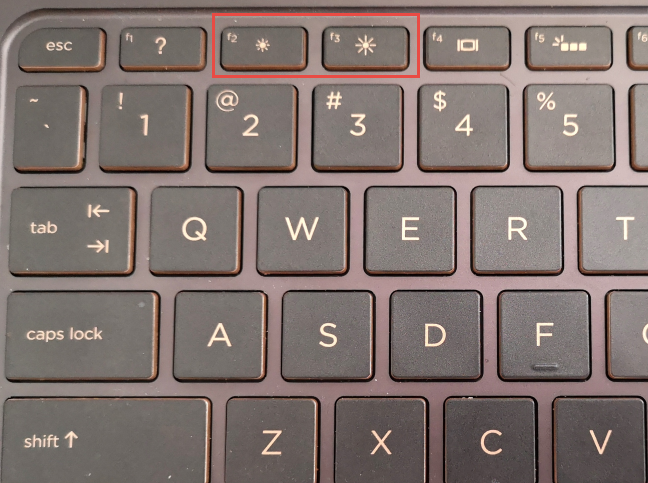 Tastele concepute pentru a ajusta luminozitatea pe o tastatură HP