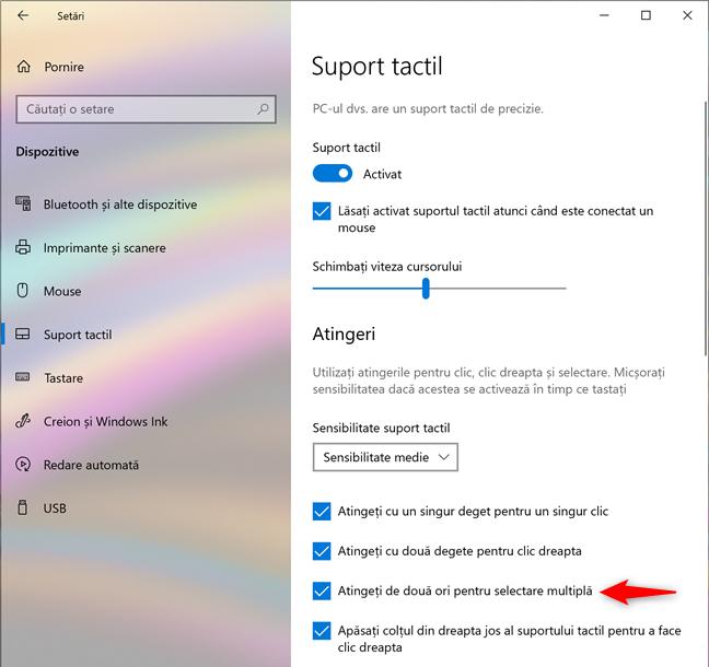 Setarea touchpad-ului pentru selectarea multiplă prin atingerea sa de două ori