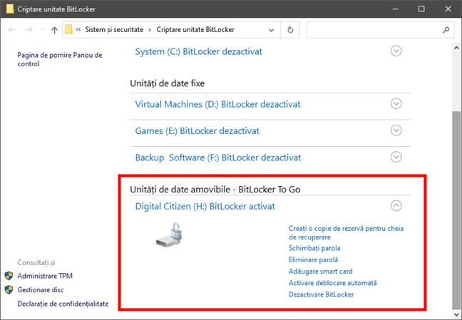 Lista de opțiuni de gestionare BitLocker disponibile pentru un stick USB