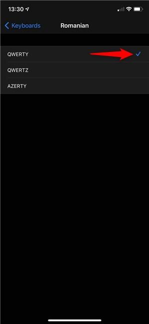 Selectează o configurație de tastatură pentru iPhone apăsând pe ea