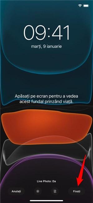 Apasă Fixați pentru a schimba fundalul pentru iPhone