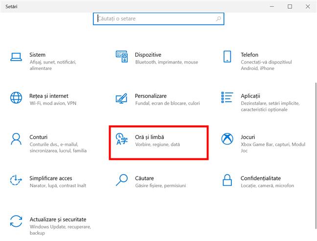 În Setările din Windows 10 , accesează Oră și limbă