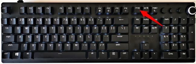Butonul Print Screen pe tastatura unui calculator