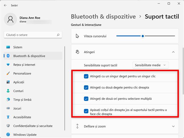 Configurează ce se întâmplă când atingi touchpadul în Windows 11
